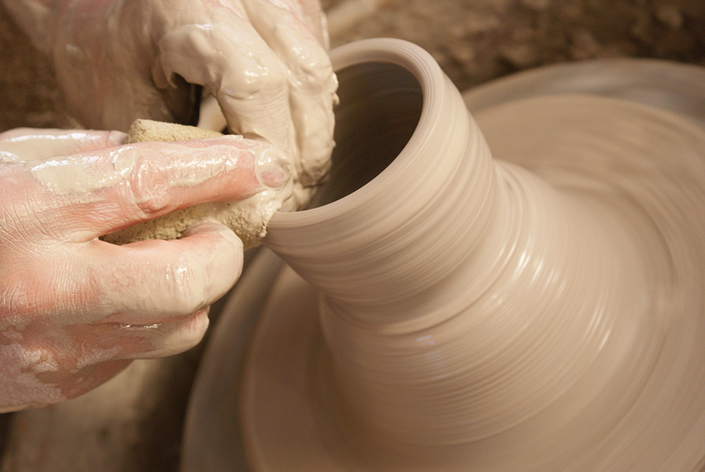 New School Pottery - Process of throwing clay on the wheel